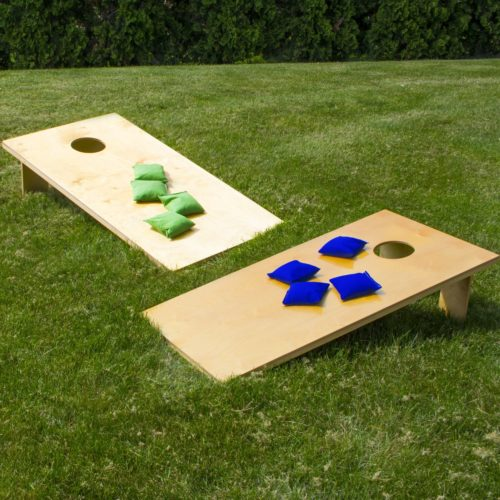 cornhole games - fun outdoors next to the river